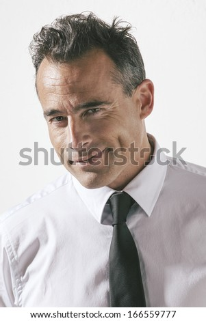 Elegant smiling man portrait./ Elegant smiling man portrait. - stock photo