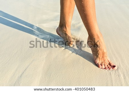 Elegant step on a sandy coral beach - stock photo