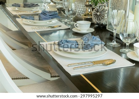 elegant table set in classic style dining room interior - stock photo