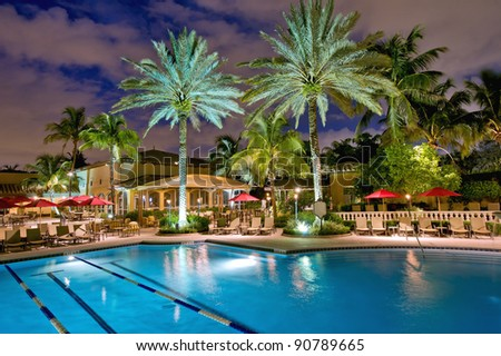 elegant tropical pool and patio at night - stock photo