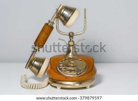 Elegant vintage telephone covered in brown leather - stock photo