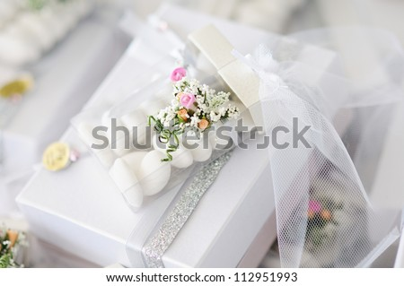 Elegant Wedding Favors decorated with artificial flowers - stock photo