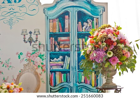 Elegant wedding reception area, ready for guests and the bridal party. Rich bunch of flowers. - stock photo