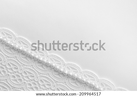 Elegant white background with lace, silk and pearls - stock photo