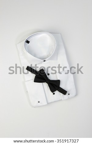 Elegant white shirt for men with black bow tie - stock photo