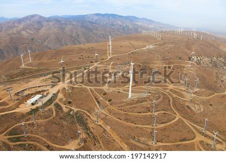 Elegant white wind turbines in the California dessert - stock photo