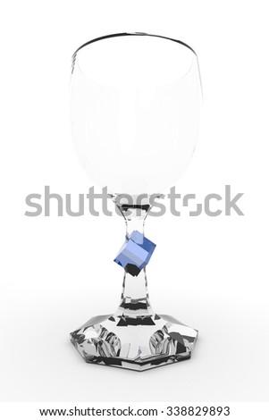 elegant wine glass with blue decorative cube on white background - stock photo