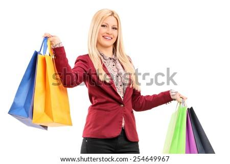 Elegant woman holding shopping bags isolated on white background - stock photo