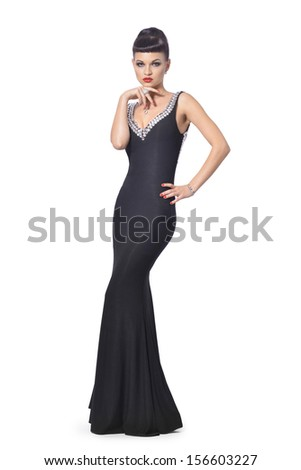 Elegant woman in black cocktail dress - stock photo
