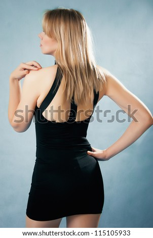 elegant  woman in black dress - stock photo