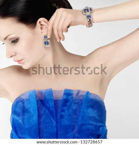 elegant woman in blue silk evening dress - stock photo