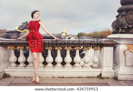 Elegant woman on  Alexandre Bridge at dawn, in Paris, France - stock photo