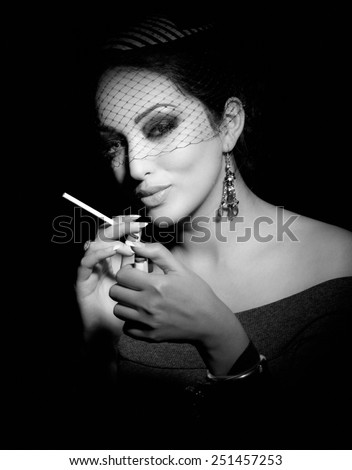 Elegant woman smoking. - stock photo