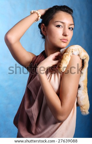 Elegant woman touching head with hands - stock photo