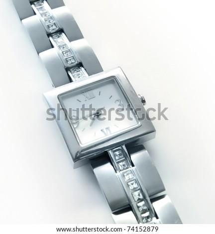 Elegant women's luxury silver wrist watch with diamonds - stock photo