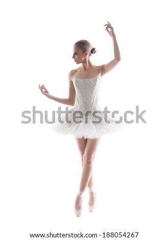 Elegant young ballerina isolated on white backdrop - stock photo
