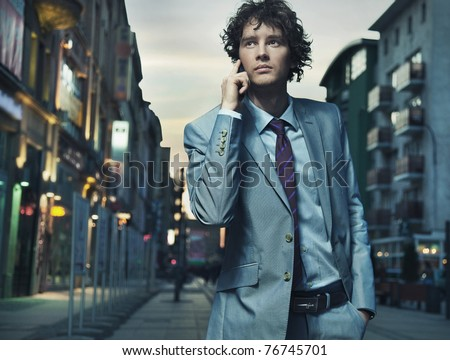 Elegant young businessman talking over cellphone - stock photo