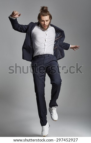 Elegant young guy jumping - stock photo