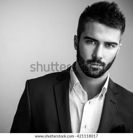 Elegant young handsome man. Black-white studio fashion portrait.  - stock photo