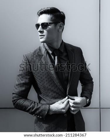 Elegant young handsome man. Fashion shoot. - stock photo