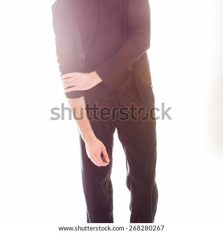 Elegant young handsome man in black clothing. Studio fashion portrait. - stock photo