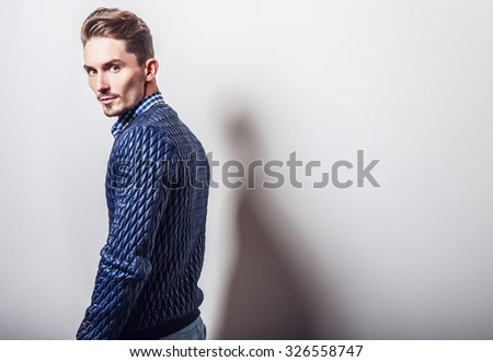 Elegant young handsome man in stylish dark blue jacket. Studio fashion portrait.  - stock photo