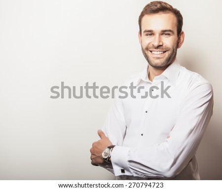 Elegant young handsome man in white shirt. Studio fashion portrait.  - stock photo