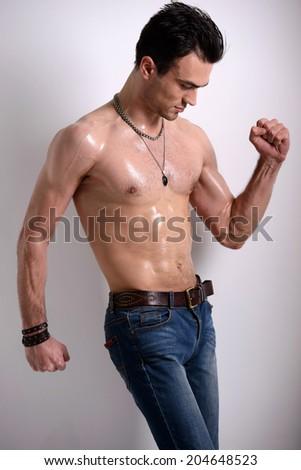 Elegant young handsome man. Naked torso. Studio portrait of fashion. - stock photo