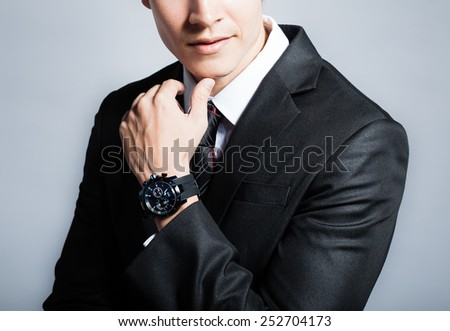 Elegant young man in suit - stock photo