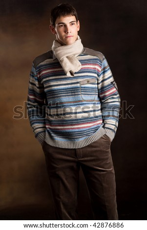 elegant young man in winter clothes studio shot - stock photo
