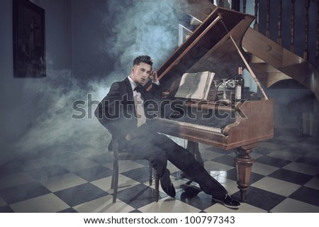 Elegant young man with piano - stock photo