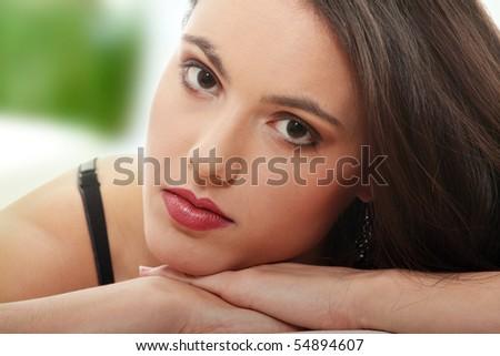 Elegant young woman close up portrait - stock photo