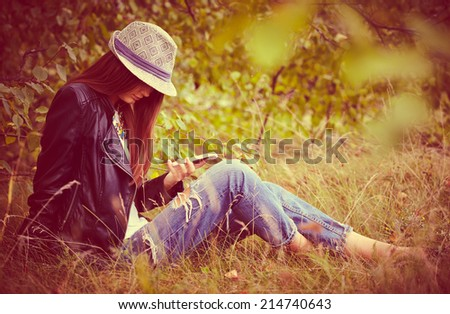 Elegant young woman in autumn cloth with mobile phone  - stock photo