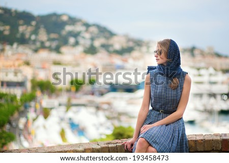 Elegant young woman in the Old town of Cannes, France - stock photo