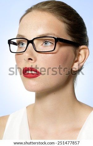 Elegant young woman wearing glasses. - stock photo