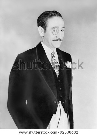 Elegantly dressed man with a monocle - stock photo
