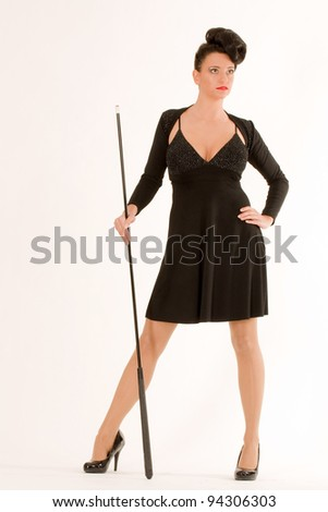 Elegantly dressed woman with billiard cues and fashionable hairstyle / elegant Fashion - stock photo