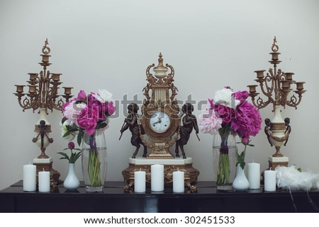 elegantly stylish conceptual creative tastefully decorated restaurant with pink peonies and ornaments for wedding - stock photo