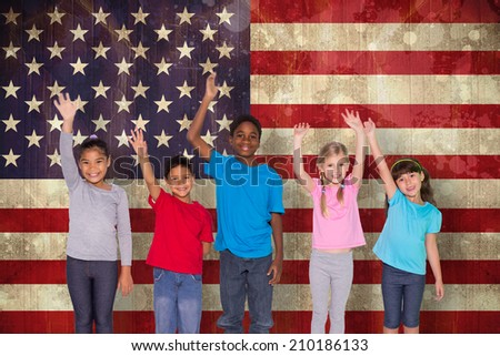 Elementary pupils smiling and waving against usa flag in grunge effect - stock photo