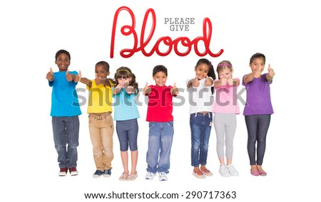 Elementary pupils smiling showing thumbs up against blood donation - stock photo