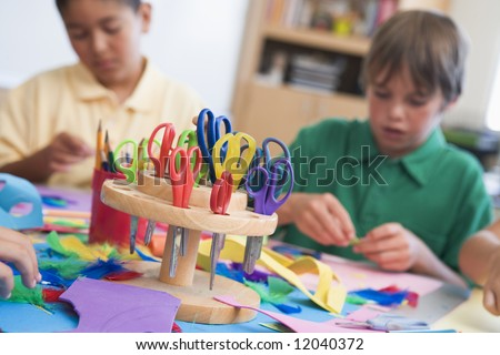 Elementary school art class with pupils - stock photo