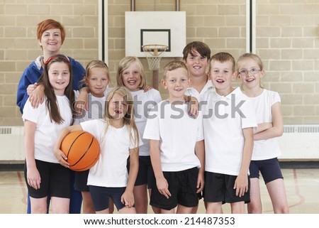 Elementary School Basketball Team With Coach - stock photo