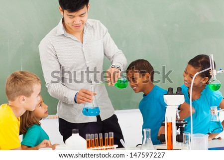 elementary school chemistry experiment in classroom - stock photo