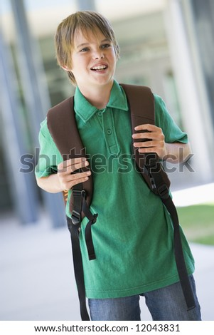 Elementary school pupil outside with rucksack - stock photo