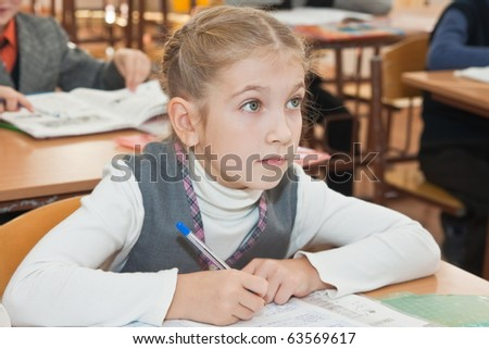 Elementary school. Schoolgirl at a lesson - stock photo