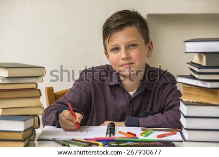 Elementary school student doing homework. - stock photo
