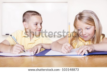 Elementary School Students doing Homework - stock photo