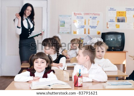 Elementary school students in a classroom - stock photo