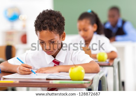 elementary school students in classroom with teacher - stock photo