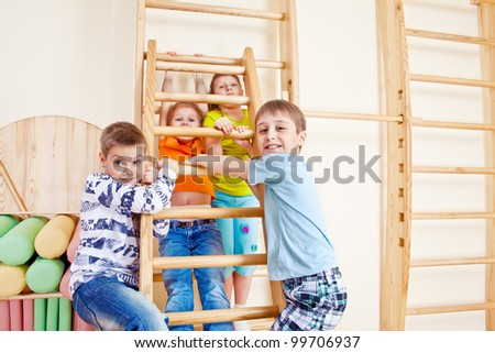 Elementary school students playing in gym - stock photo